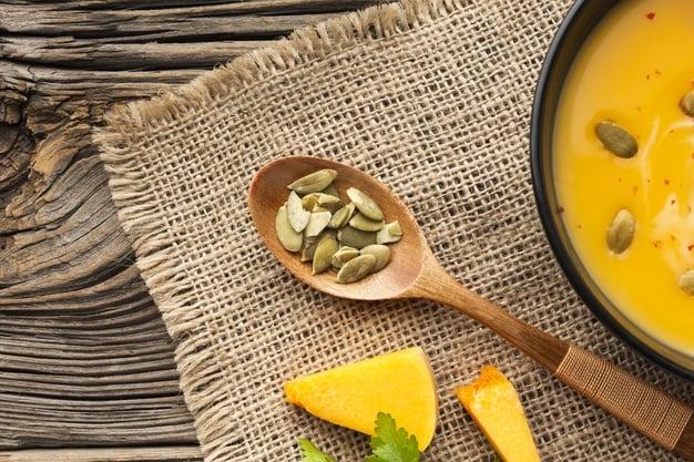 pumpkin-soup-bowl-wooden-spoon-with-pumpkin seeds