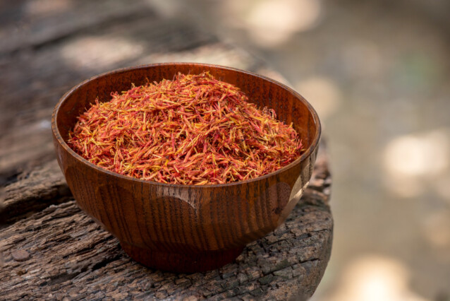 a wooden bowl containing dried safflower